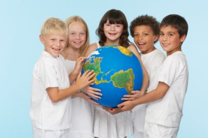 ethnically diverse smiling children on white clothes hold world globe