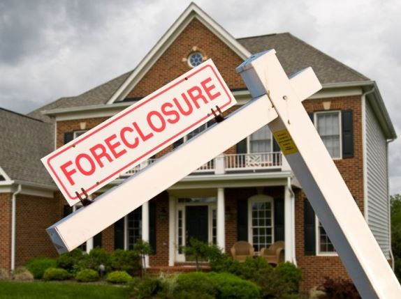 House with foreclosure sign outside