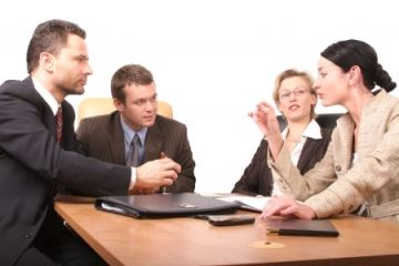 Professional looking business people have converse during meeting