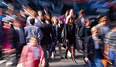 crowd of people walking on the street with blur effect